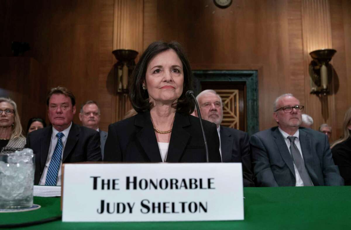 FILE - In this Feb. 13, 2020 file photo, President Donald Trump's nominee to the Federal Reserve, Judy Shelton, appears before the Senate Banking Committee for a confirmation hearing, on Capitol Hill in Washington. In a shift, the Senate Banking Committee is likely to back President Donald Trump's unconventional nomination of Shelton for the Federal Reserve's Board of Governors in a party-line vote Tuesday, July 21. (AP Photo/J. Scott Applewhite, File)