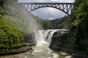 View of the upper falls, Genesee River gorge and new Genesee Arch Bridge in Letchworth State Park, located in Livingston and Wyoming counties, New York, USA. It is popularly known as the Grand Canyon of the East.