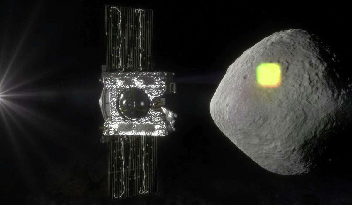 This artist's rendering made available by NASA in July 2016 shows the mapping of the near-Earth asteroid Bennu by the OSIRIS-REx spacecraft. (NASA/Goddard/University of Arizona via AP)