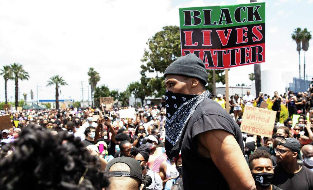 Rockets guard Russell Westbrook, pictured at a protest in Compton, Calif., in early June, on Wednesday urged people to wear masks to combat the spread of COVID-19 and also stressed the importance of recognizing social injustice.
