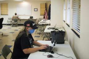 Mary Sanik works at a laptop inside the Jerome Township Hall, which is available for anyone in need of internet access, Wednesday, July 22, 2020 in Sanford. The space is available Wednesdays from 8 a.m. - 12 p.m., Thursdays from 4 p.m. - 8 p.m. and Saturdays from 9 a.m. - 1 p.m. First United Methodist Church in Midland is also available for internet access, on Tuesdays from 8 a.m. - 12 p.m., Wednesdays from 4 p.m. - 8 p.m. and Saturdays 9 a.m. - 1 p.m. (Katy Kildee/kkildee@mdn.net)