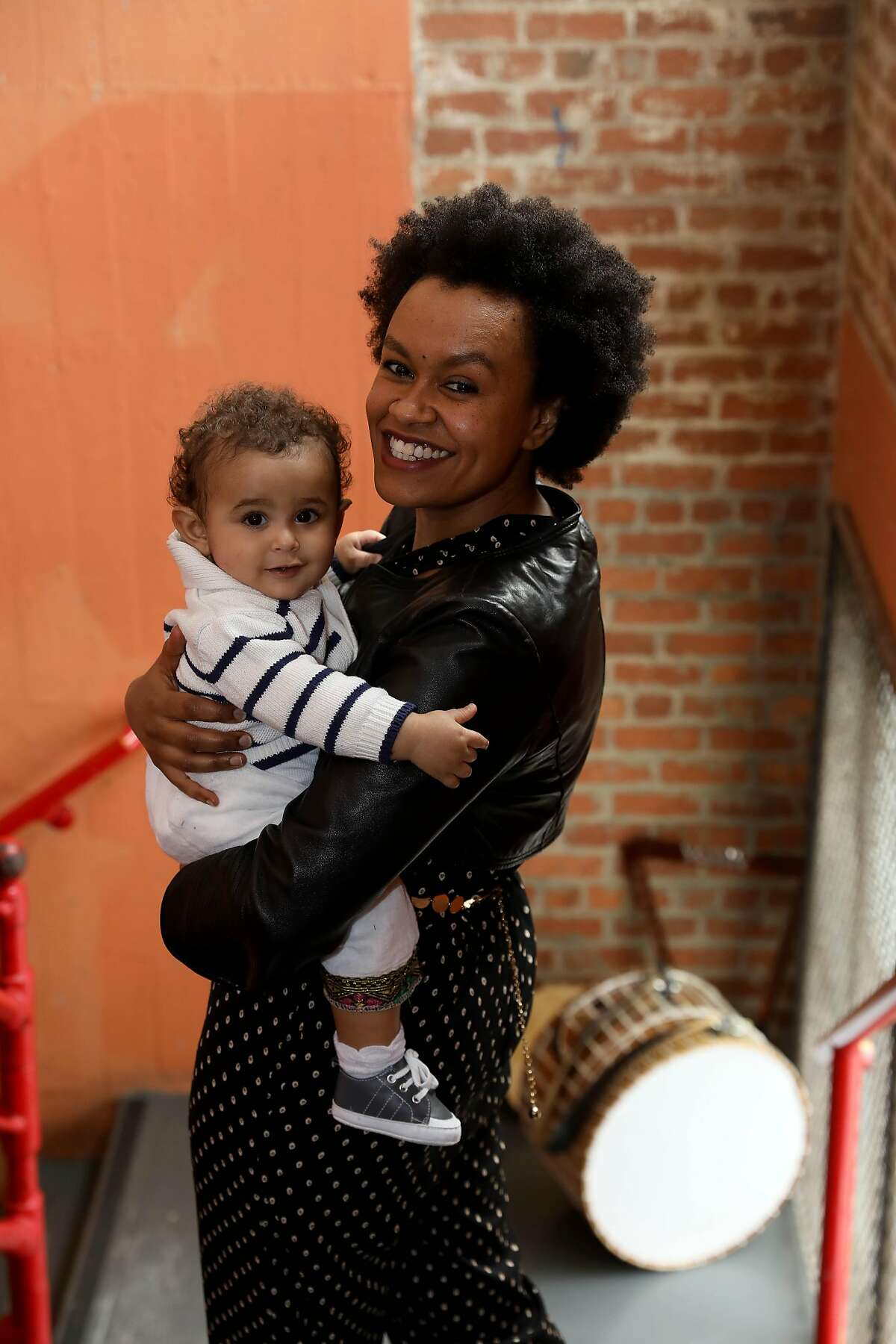 Meklit Hadero poses for a portrait with 9-month-old son Le-n Hadero Peris at Project Artaud on Saturday, May 2, 2020, in San Francisco, Calif.
