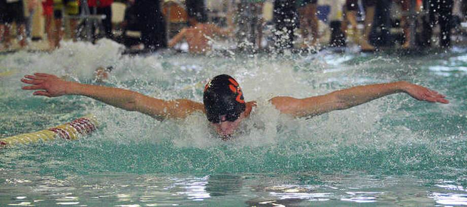 Edwardsville senior Logan Mills swims in the 200-yard medley relay during the Sacred Heart-Griffin Sectional on Feb. 22 at Eisenhower Pool in Springfield. Photo: Scott Marion/The Intelligencer