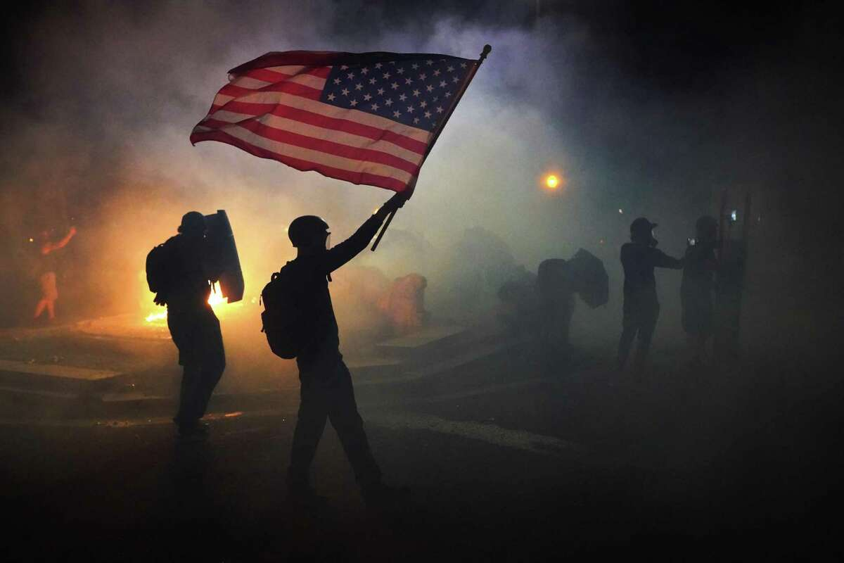 Protesters walk through tear gas fired by federal officers in Portland, Ore. The use of Border Patrol agents against Americans is particularly terrifying.
