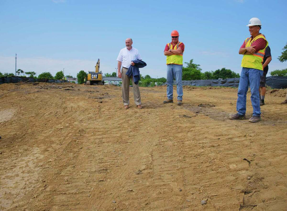 Troy Mayor Patrick Madden, left, Tim farrell, resident engineer with Creighton Manning, center, and Andrew Kreshik, assistant planner with the City of Troy Planning Department, stand on a new section of what will become River St. when the South Troy Industrial Road project is complete. Photo taken on Wednesday, July 22, 2020, in Troy, N.Y. (Paul Buckowski/Times Union)