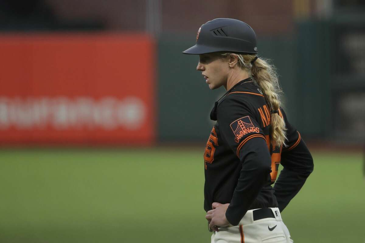 San Francisco Giants first base coach Alyssa Nakken watches during an exhibition baseball game against the Oakland Athletics in San Francisco, Tuesday, July 21, 2020.