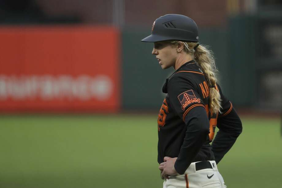 San Francisco Giants first base coach Alyssa Nakken watches during an exhibition baseball game against the Oakland Athletics in San Francisco, Tuesday, July 21, 2020. Photo: Jeff Chiu/Associated Press / Copyright 2020 The Associated Press. All rights reserved