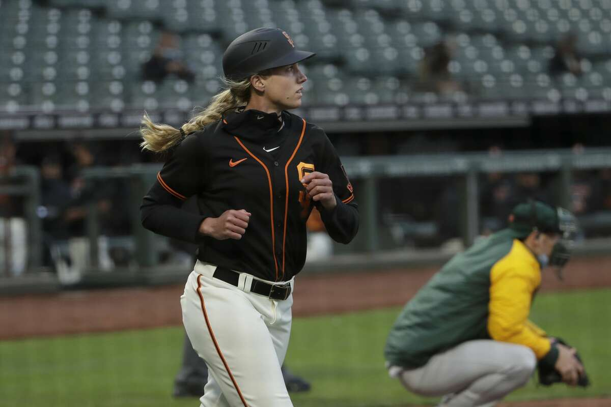 San Francisco Giants first base coach Alyssa Nakken jogs to first base during the second inning of an exhibition baseball game against the Oakland Athletics in San Francisco, Tuesday, July 21, 2020.