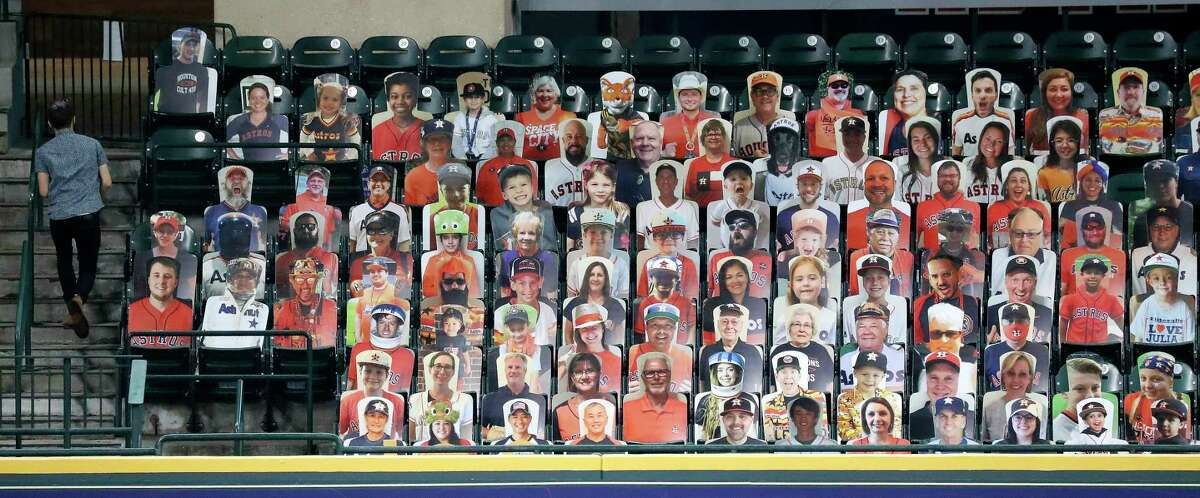 Cardboard cutout photos of Houston Astros fans in the Crawford Boxes during the Astros summer camp at Minute Maid Park, Wednesday, July 22, 2020, in Houston.