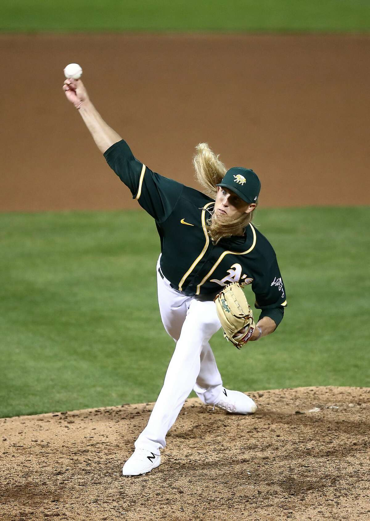 OAKLAND, CALIFORNIA - JULY 20: Jordan Weems #70 pitches against the San Francisco Giants in the seventh inning during their exhibition game at Oakland-Alameda County Coliseum on July 20, 2020 in Oakland, California. (Photo by Ezra Shaw/Getty Images)