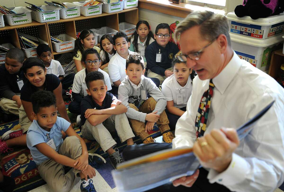 Morgan Stanley Managing Director Brad Barber, of New Canaan, reads the book Rice & Rocks, written by his co-worker, Sandra Richards, to students at Cesar Batalla School as part of Read Aloud Day in Bridgeport, Conn. on Thursday, October 19, 2017. Barber's company purchased one hundred copies of the book which they donated to every third grade classroom in the city.