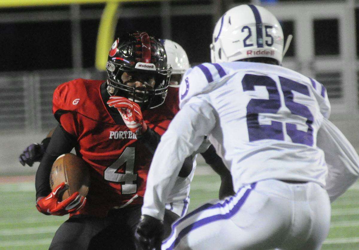 Porter's Marlon Lewis makes a move on a Dayton defender at New Caney ISD Stadium on Friday in New Caney.