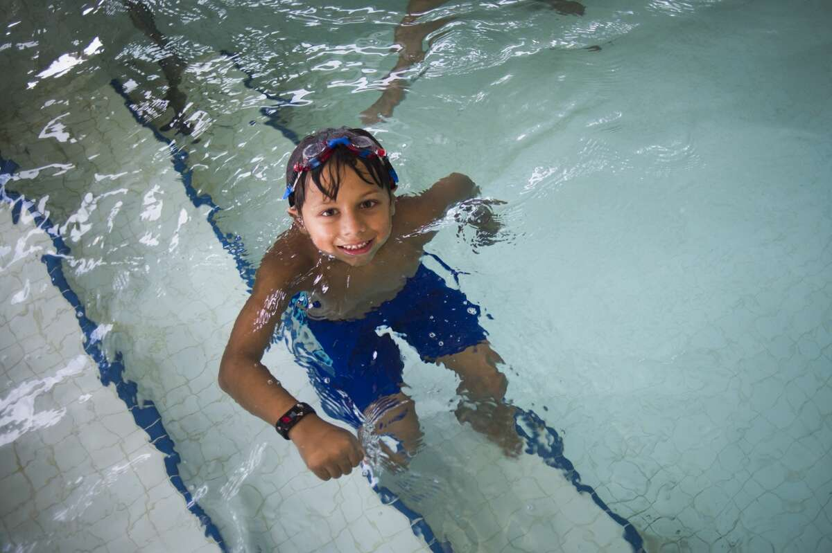 Eelan Weiler, 7, swims in the pool during a day camp Wednesday, July 22, 2020 at Greater Midland Community Center. (Katy Kildee/kkildee@mdn.net)