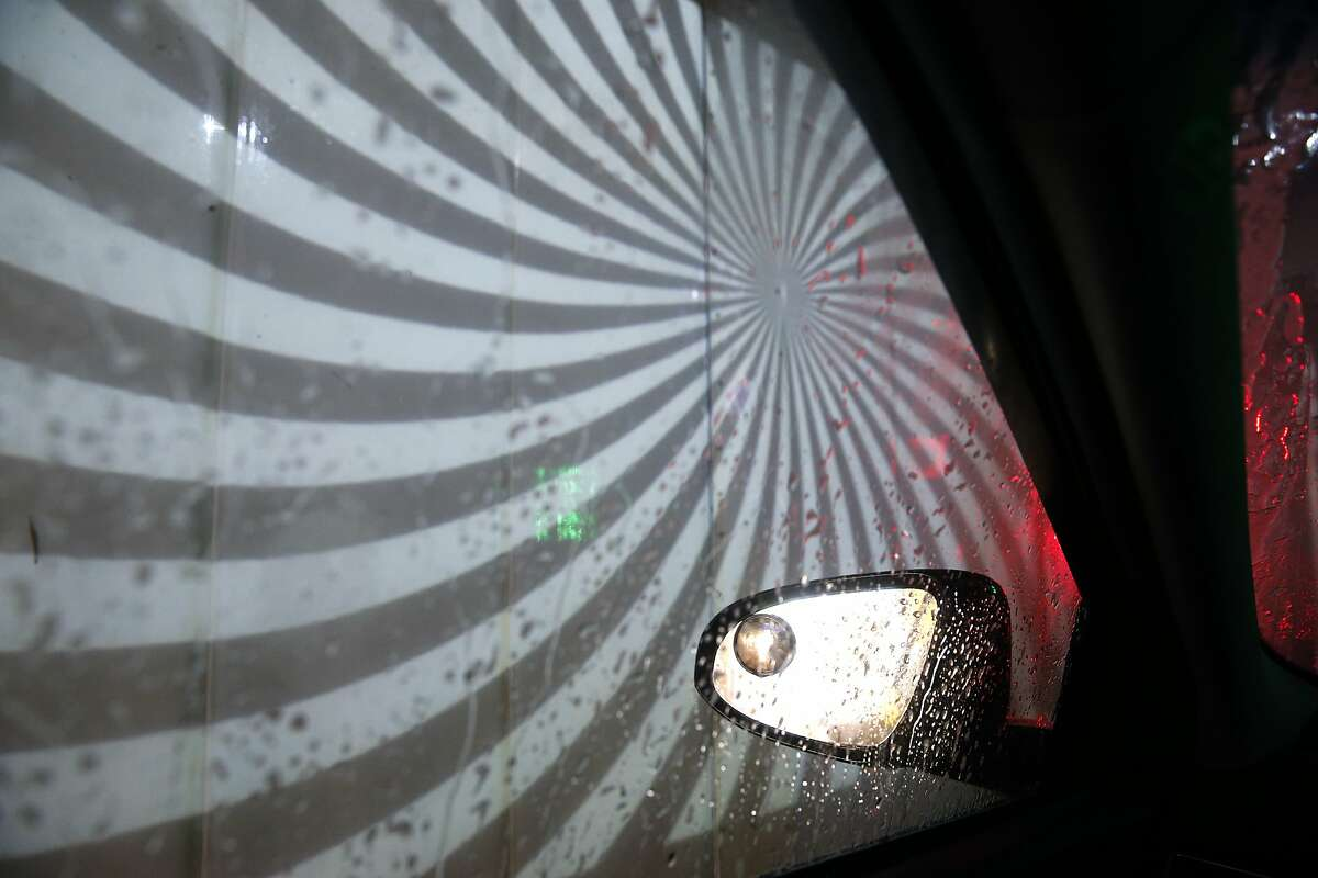 Drivers having their car washed are entertained by a virtual reality video experience in San Bruno, Calif. on Wednesday, July 15, 2020. The Shell gas station and car wash across from the Tanforan shopping mall is also adorned with nautically-themed and satirical sculptures.