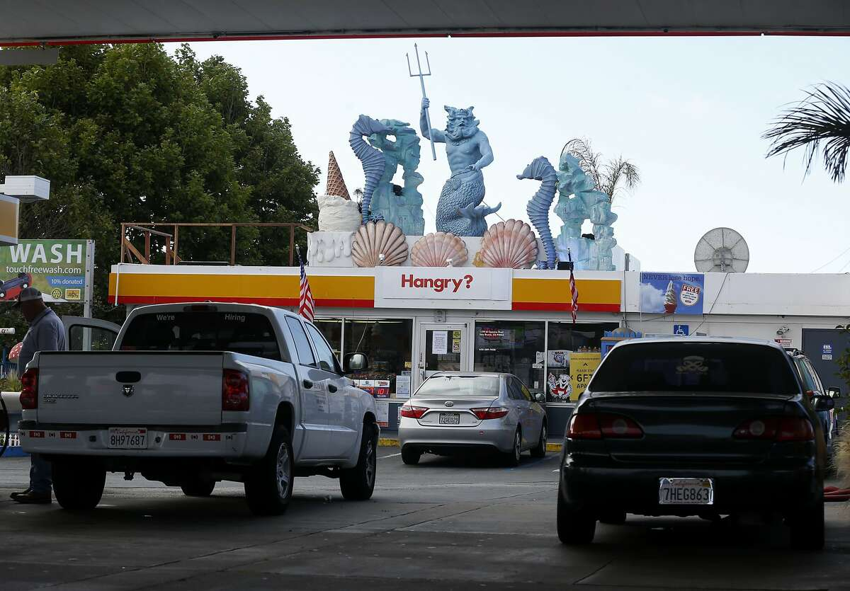 The Shell gas station across from the Tanforan shopping mall is also adorned with nautically-themed and satirical sculptures in San Bruno, Calif. on Wednesday, July 15, 2020 but the top attraction is the virtual reality video car wash.