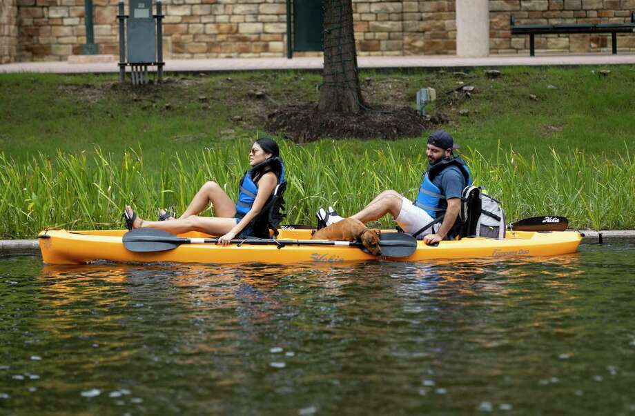 After a more than two-week closure, the Riva Row Boat House in The Woodlands will be reopened on Thursday, July 23, and renting the usual watercraft to fun-seekers along The Woodlands Waterway and Lake Woodlands. Two people with a dog peddle through the waterway in The Woodlands, Sunday, June 28, 2020. New equipment was added at the Riva Row Boat House for visitors to rent. Photo: Gustavo Huerta, Houston Chronicle / Staff Photographer / Houston Chronicle © 2020