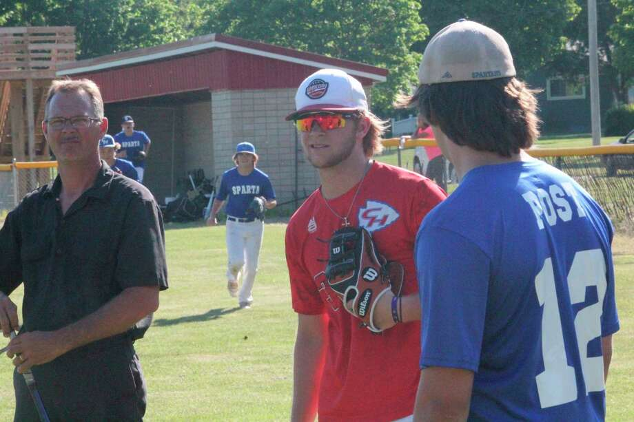 Ian Bissell (center) of Chippewa Hills has been among the standouts for the local 16U baseball team this summer. (Pioneer file photo)