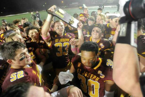 St Joseph celebrates their 17-13 win over Hand in the CIAC Class L state championship football game at Veterans Memorial Stadium in New Britian, Connecticut on Dec. 14, 2019.