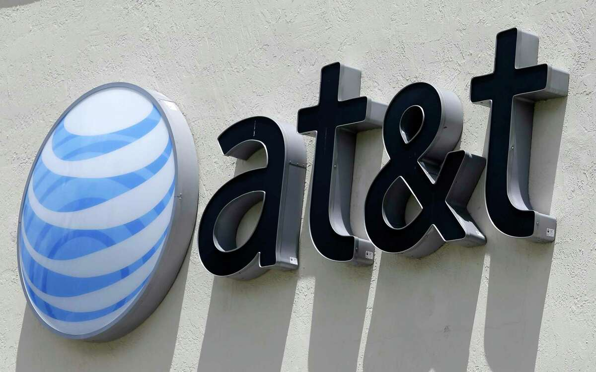 FILE - This July 27, 2017, file photo shows an AT&T logo at a store in Hialeah, Fla. AT&T resumes data caps on its AT&T Internet service on New Year's Day.