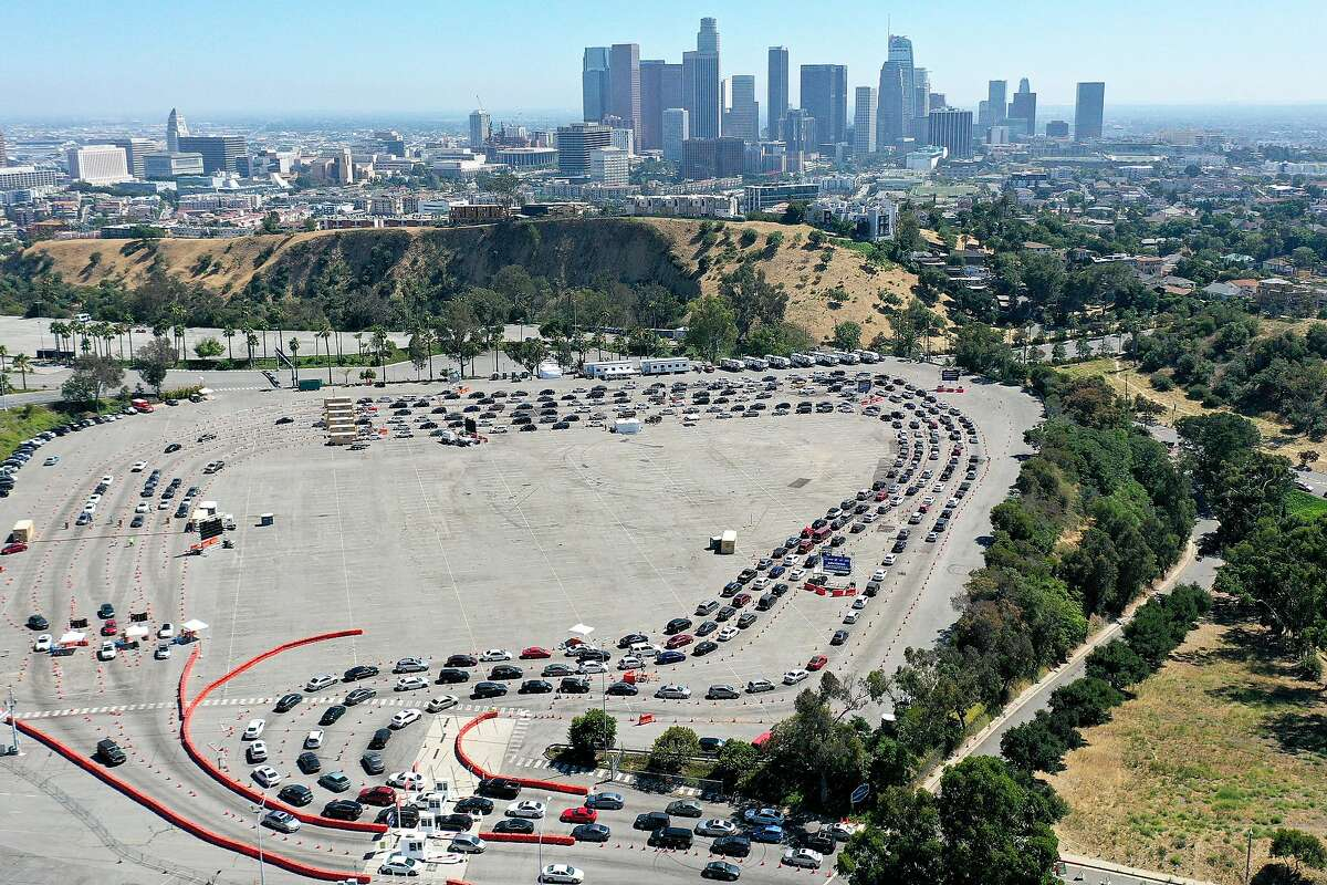 An aerial view of motorists lined up to be tested for COVID-19 in a parking lot at Dodger Stadium amid the coronavirus pandemic on July 10, 2020 in Los Angeles, California.