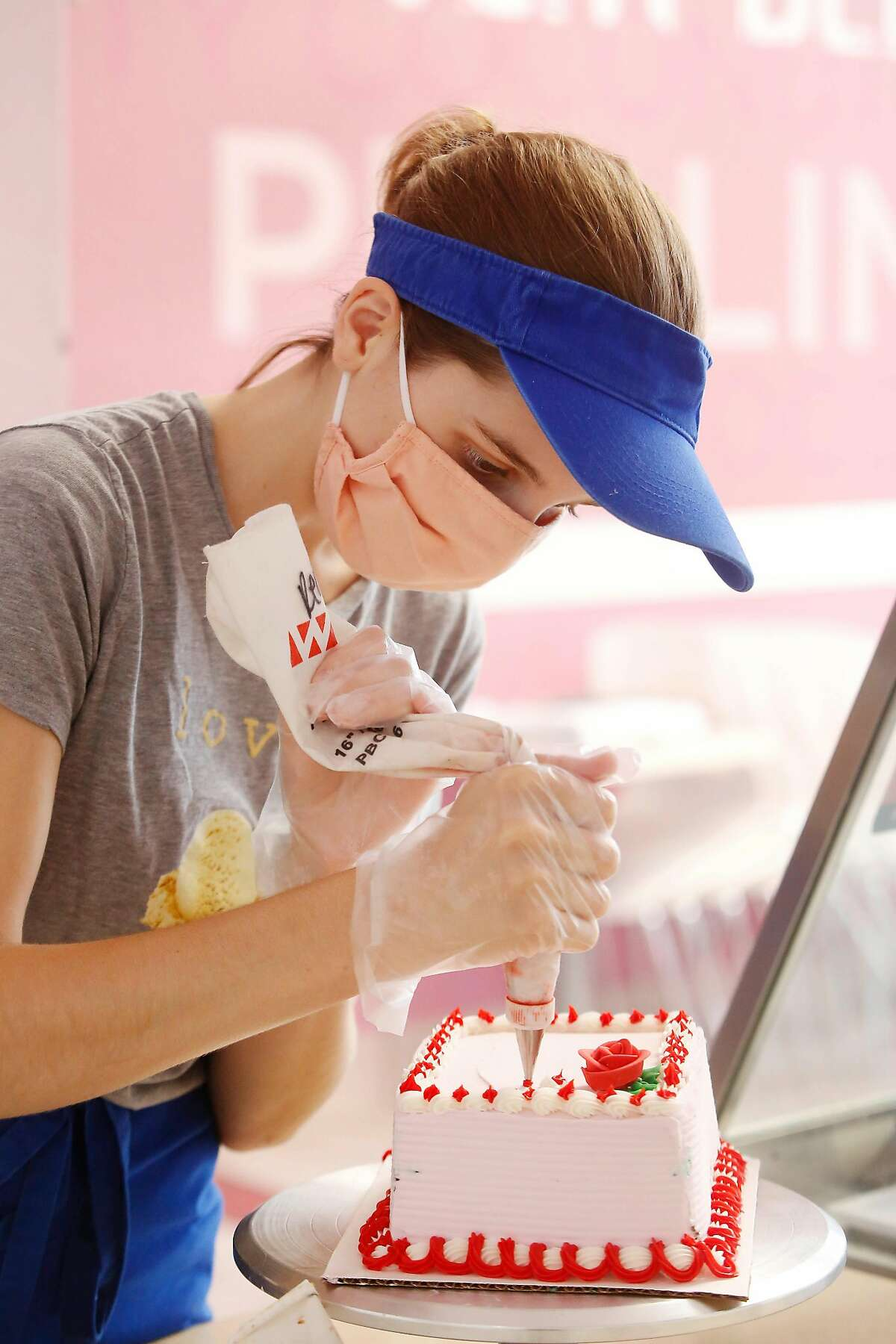 Abby Hasselbrink decorates a cake as she works at Baskin-Robbins on Monday, July 20, 2020 in San Ramon, Calif. Abby Hasselbrink is a Holy Names-Oakland gradudate who works at Baskins-Robbins. She plans to work there the rest of the year then travel thru Pacific Discovery gap-year program next spring before starting at Denison University in Ohio in fall '21.