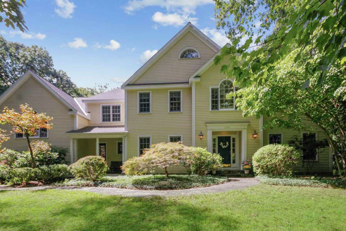 The 4,530-square-foot colonial house at 284 Newtown Turnpike sits on a 2.15-acre property in Weston.