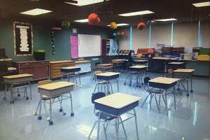 A New Milford classroom is set up for social distancing with 6 feet between each desk.