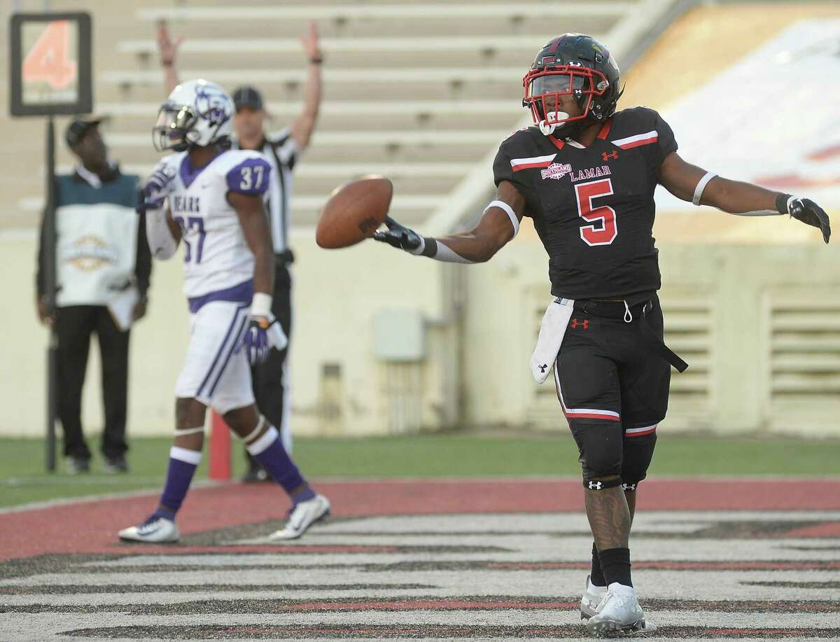 Lamar's Myles Wanza tosses off the ball after getting a second touchdown against Central Arkansas during their game at Lamar Saturday. Photo taken Saturday, November 2, 2019 Kim Brent/The Enterprise