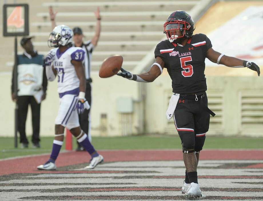 Lamar's Myles Wanza tosses off the ball after getting a second touchdown against Central Arkansas during their game at Lamar Saturday. Photo taken Saturday, November 2, 2019 Kim Brent/The Enterprise Photo: Kim Brent / The Enterprise / BEN