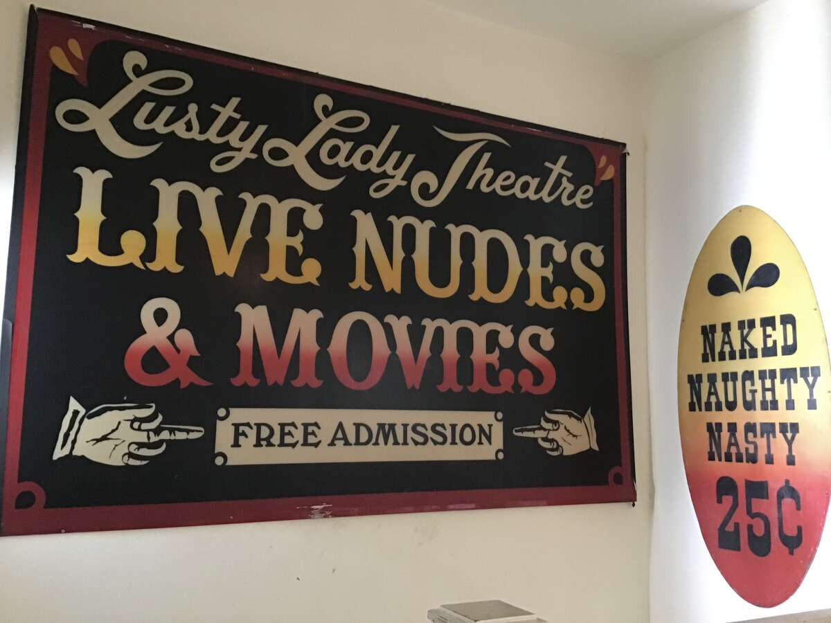 Some of the Lusty Lady's signs now decorate author and former dancer Jennifer Worley's apartment in San Francisco.