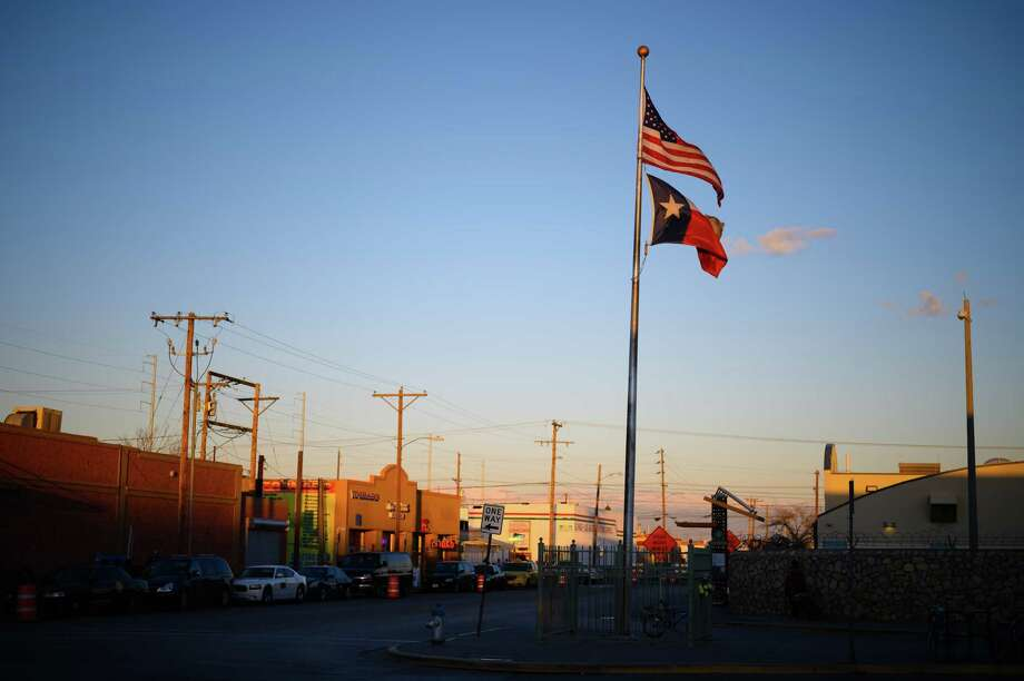 An American flag and a Texan flag fly outside of a U.S. Customs and Border Protection building in El Paso. Photo: Washington Post Photo By Sarah L. Voisin / The Washington Post