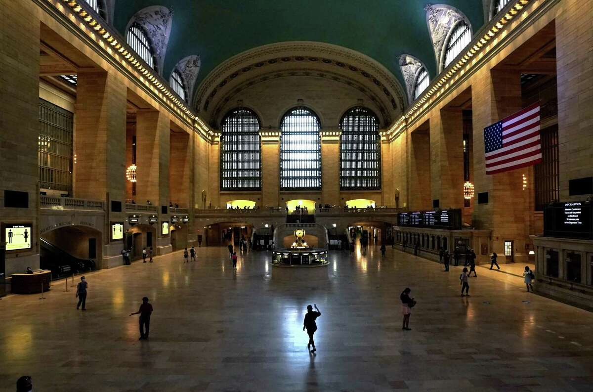 A quiet Grand Central Terminal in New York City on Tuesday, July 21, 2020, on the heels of the Partnership for New York City releasing a white paper analyzing the city's options to boost appeal among residents and businesses considering a relocation to the suburbs given the ongoing COVID-19 pandemic. (Photo by TIMOTHY A. CLARY/AFP via Getty Images)