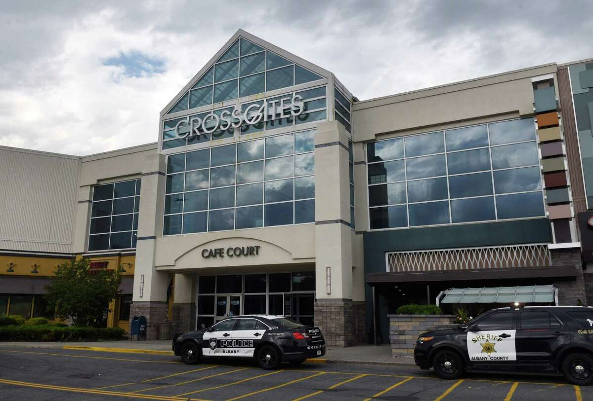 Police vehicles are at an entrance to Crossgates Mall following a report of shots fired on Wednesday, July 22, 2020, in Guilderland, N.Y. (Will Waldron/Times Union)