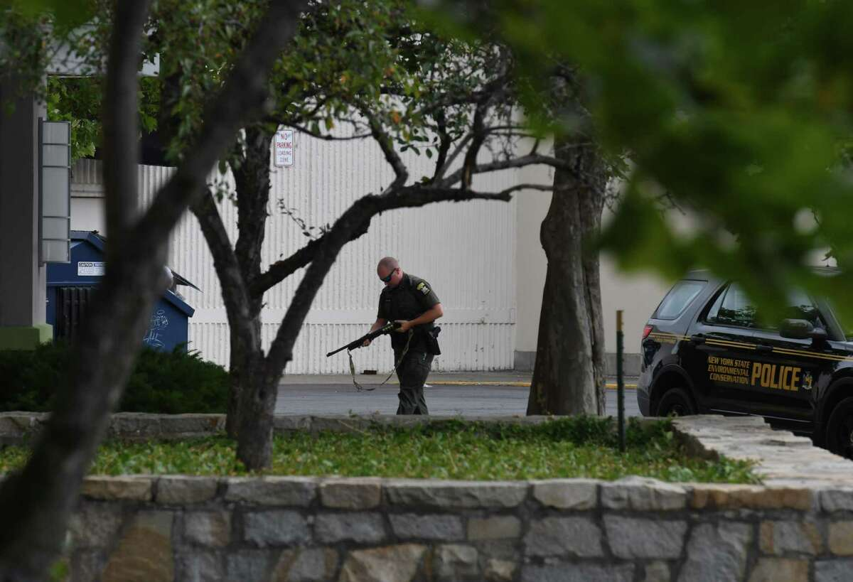 New York State Department of Conservation police were seen guarding entrance ways to Crossgates Mall near J. C. Penney following a report of shots fired on Wednesday, July 22, 2020, in Guilderland, N.Y. (Will Waldron/Times Union)