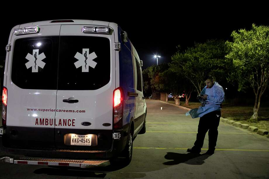 Superior Mobile Health paramedic George Lombardo makes a call after a patient with COVID-19 died on the way to hospice care. Photo: Lisa Krantz /Staff Photographer / San Antonio Express-News