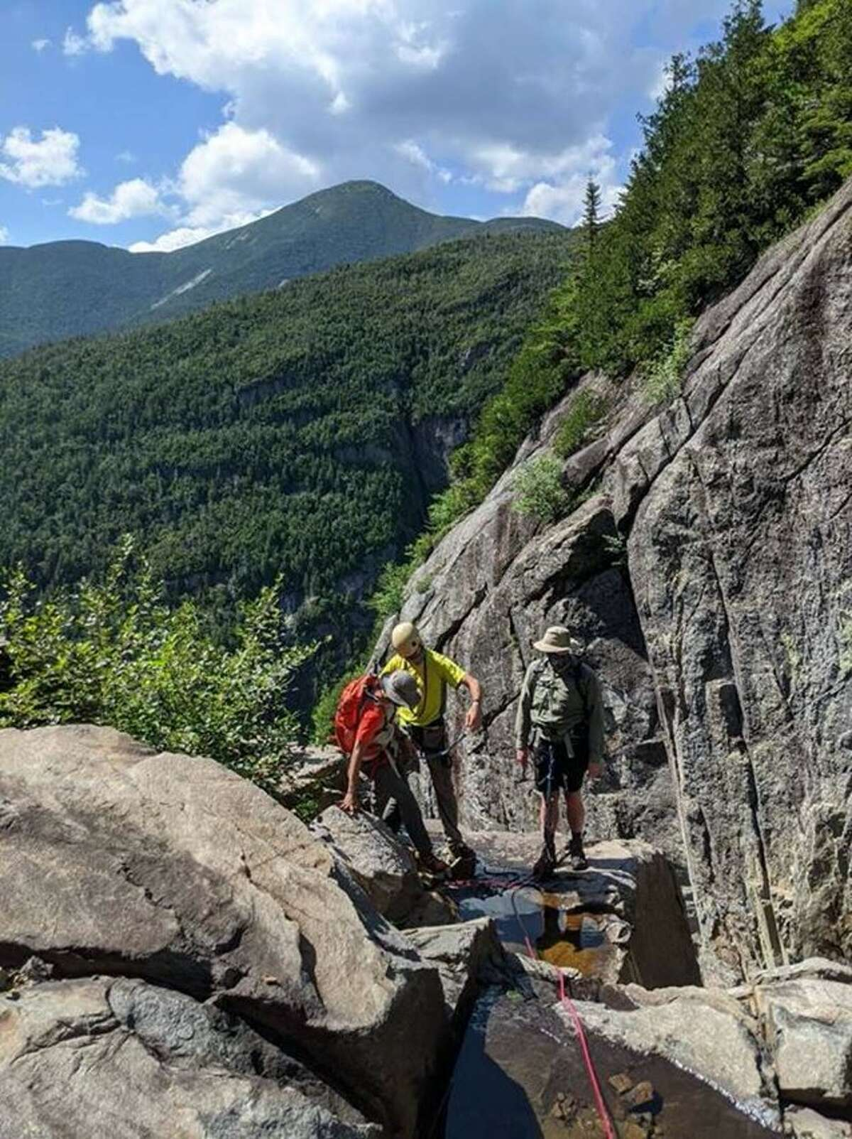 New York State Department of Environmental Conservation forest rangers assist in the rescue of two hikers stuck on Trap Dike on July 18, 2020, in the Adirondacks. (NYS DEC)