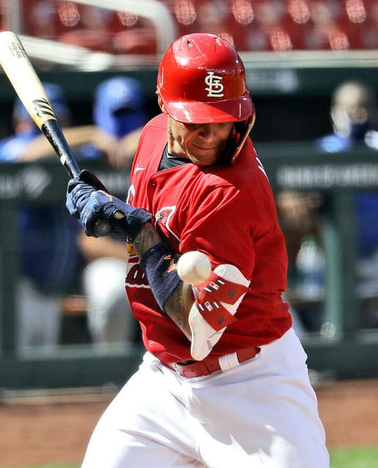 The Cardinals' Yadier Molina is hit by a pitch during the third inning of Wednesday's exhibition baseball game against the Kansas City Royals at Busch Stadium. Photo: Jeff Roberson | AP Photo
