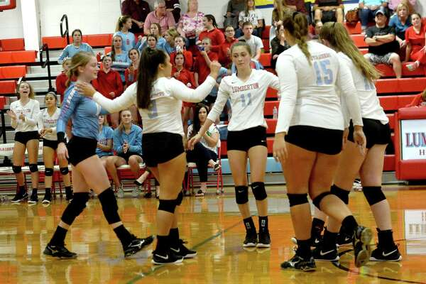 Lumberton's Lady Raiders react after a point against Silsbee during their match-up Tuesday at Lumberton. Photo taken Tuesday, September 10, 2019 Kim Brent/The Enterprise