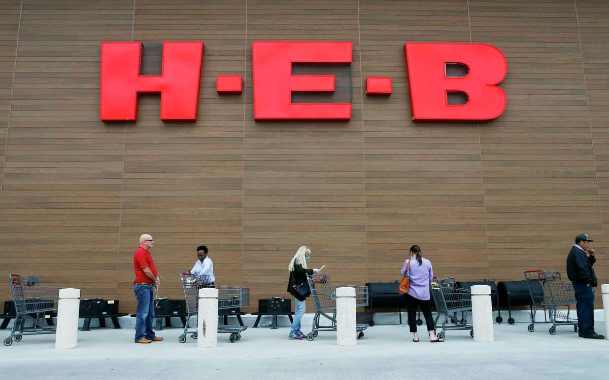 People stand outside an H-E-B in the Houston area in this file photo.