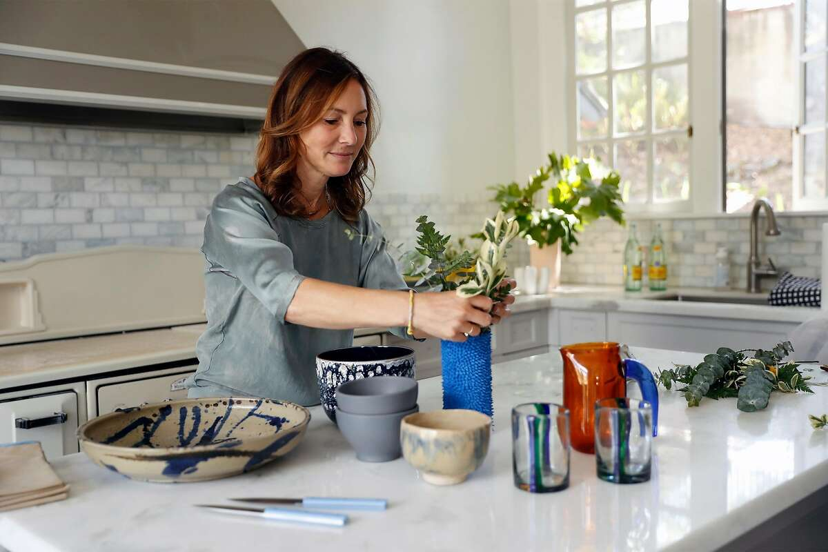Dr. Maria Raven in the kitchen oft her residence in Berkeley, Calif., on Wednesday, July 22, 2020. Dr. Raven, a chief of emergency medicine at UCSF Parnassus, is in the process of figuring out how to hold dinner parties in the age of coronavirus.