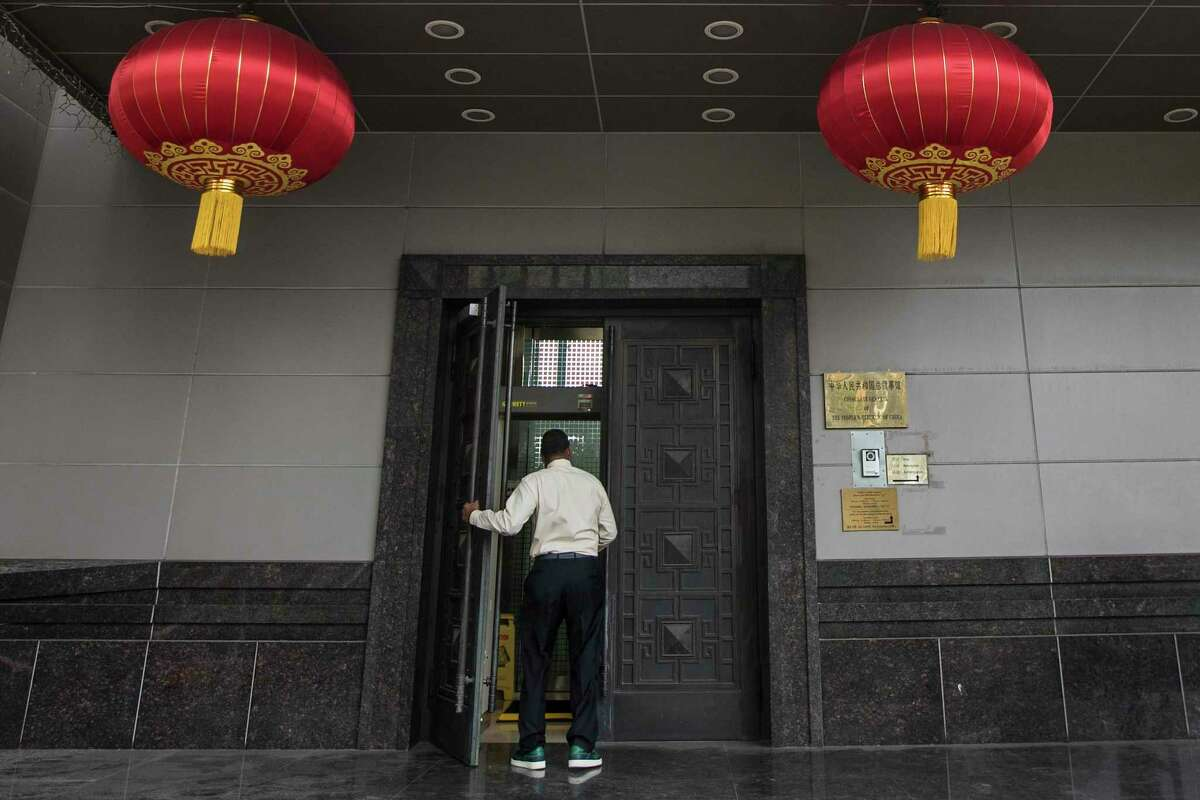 A man walks into the Consulate General of China Wednesday, July 22, 2020, in Houston. Tuesday night, Houston police and fire officials responded to reports that materials were being burned in the courtyard of the consulate, according to the Houston Police Department. China says the U.S. has ordered it to close its consulate in Houston in what it called a provocation that violates international law.