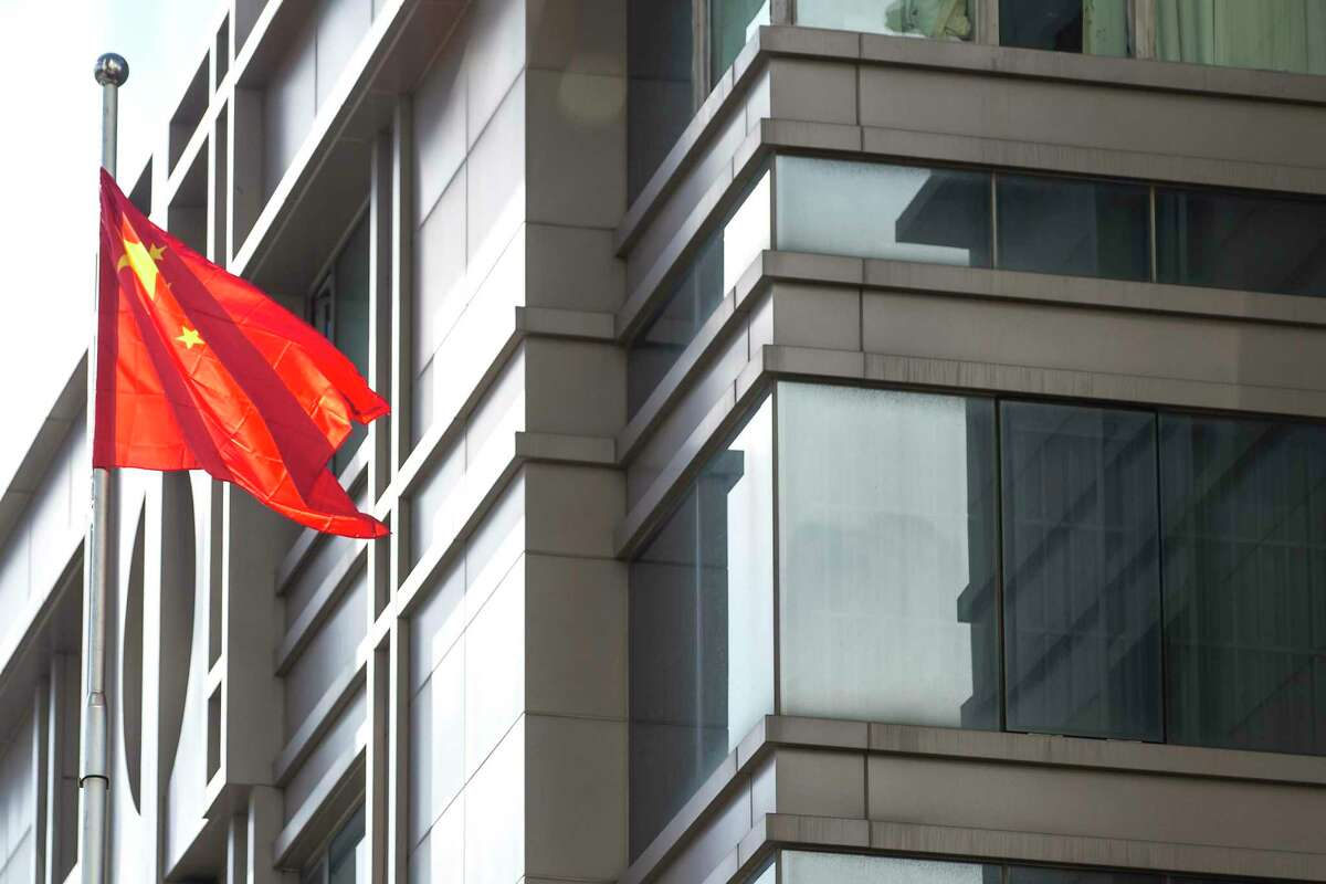 The Chinese flag flies outside the Consulate General of China Wednesday in Houston. Tuesday, police and fire officials responded to reports that materials were being burned in the courtyard of the consulate, according to HPD. China says the U.S. ordered it to close the consulate in what it called a provocation that violates international law.