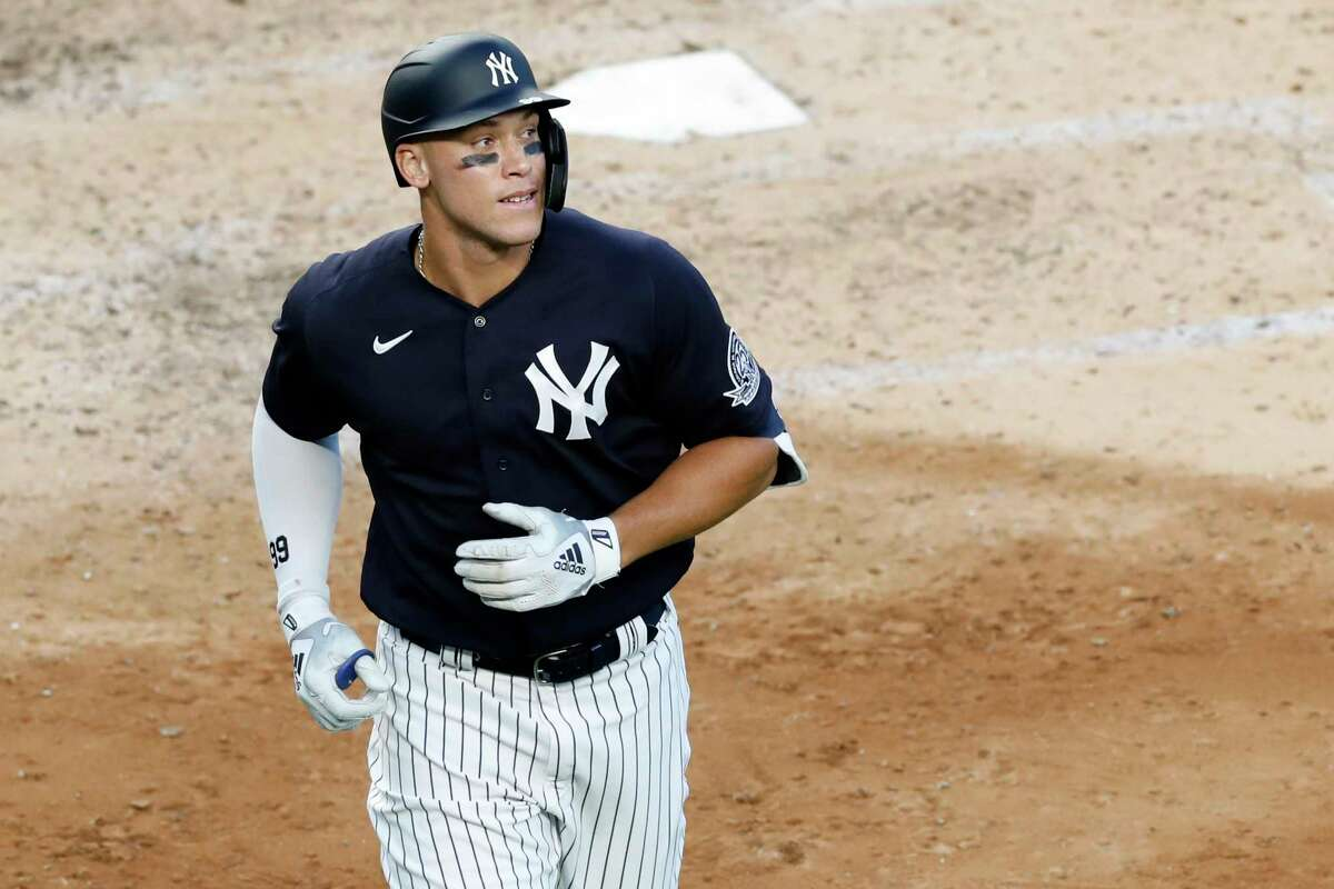 CORRECTS INNING TO FIFTH NOT SIXTH - New York Yankees' Aaron Judge looks to the outfield after hitting a solo home run during the fifth inning of an exhibition baseball game against the Philadelphia Phillies, Monday, July 20, 2020, at Yankee Stadium in New York. (AP Photo/Kathy Willens)