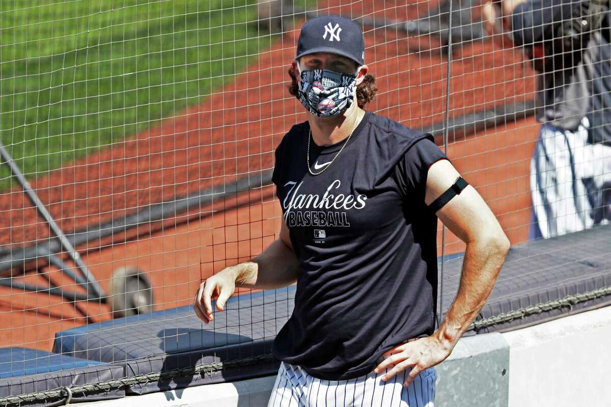 New York Yankees starting pitcher Gerrit Cole looks into the stands, empty except for a handful of media, during a baseball summer training camp workout Sunday, July 5, 2020, at Yankee Stadium in New York. (AP Photo/Kathy Willens)