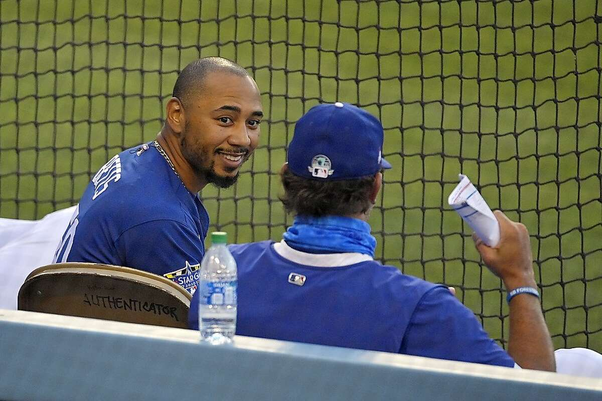 Los Angeles Dodgers right fielder Mookie Betts, left, talks to another member of the team during an intrasquad baseball game Thursday, July 9, 2020, in Los Angeles. (AP Photo/Mark J. Terrill)