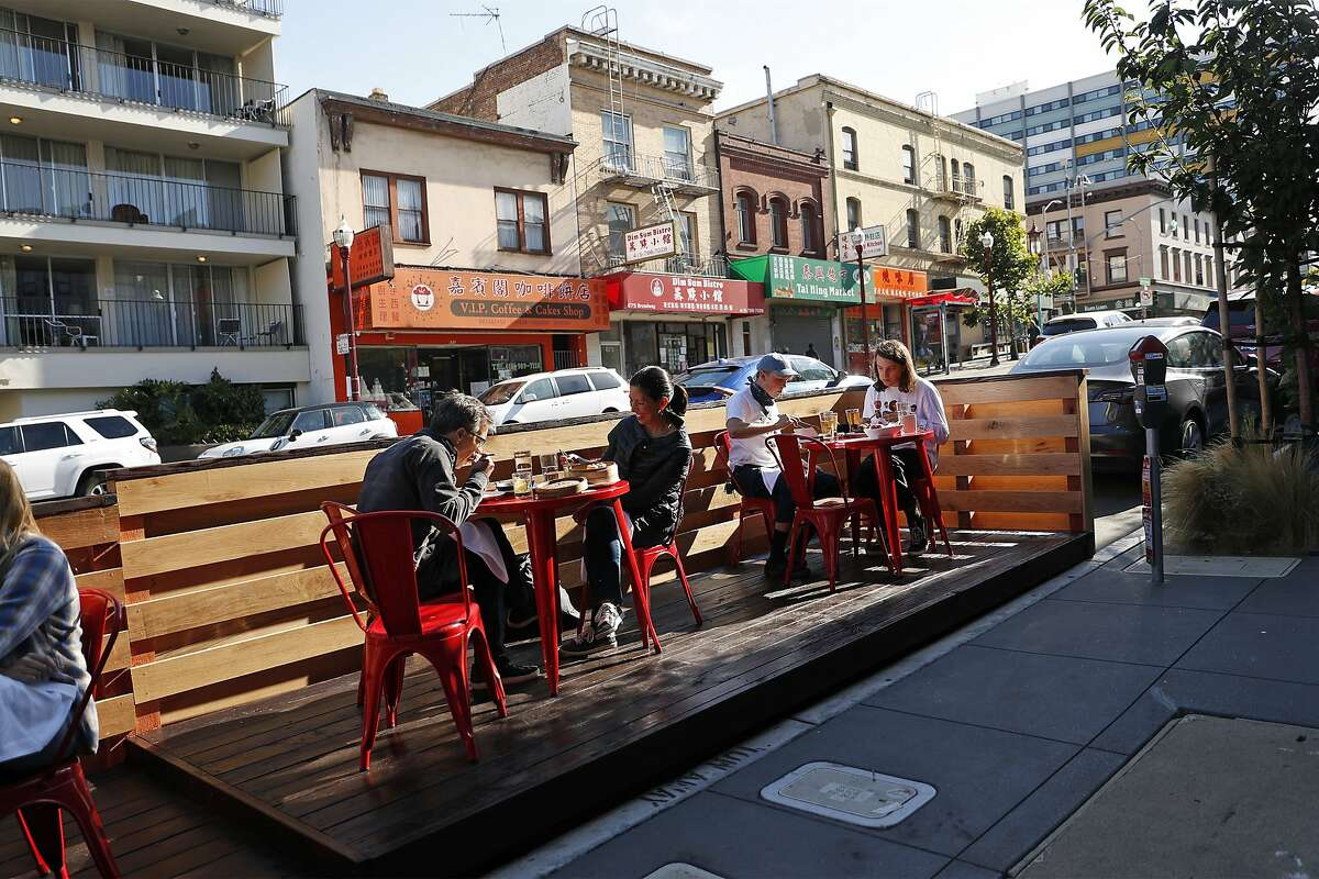 Diners take advantage of an outdoor parklet at China Live on Broadway in San Francisco in July.