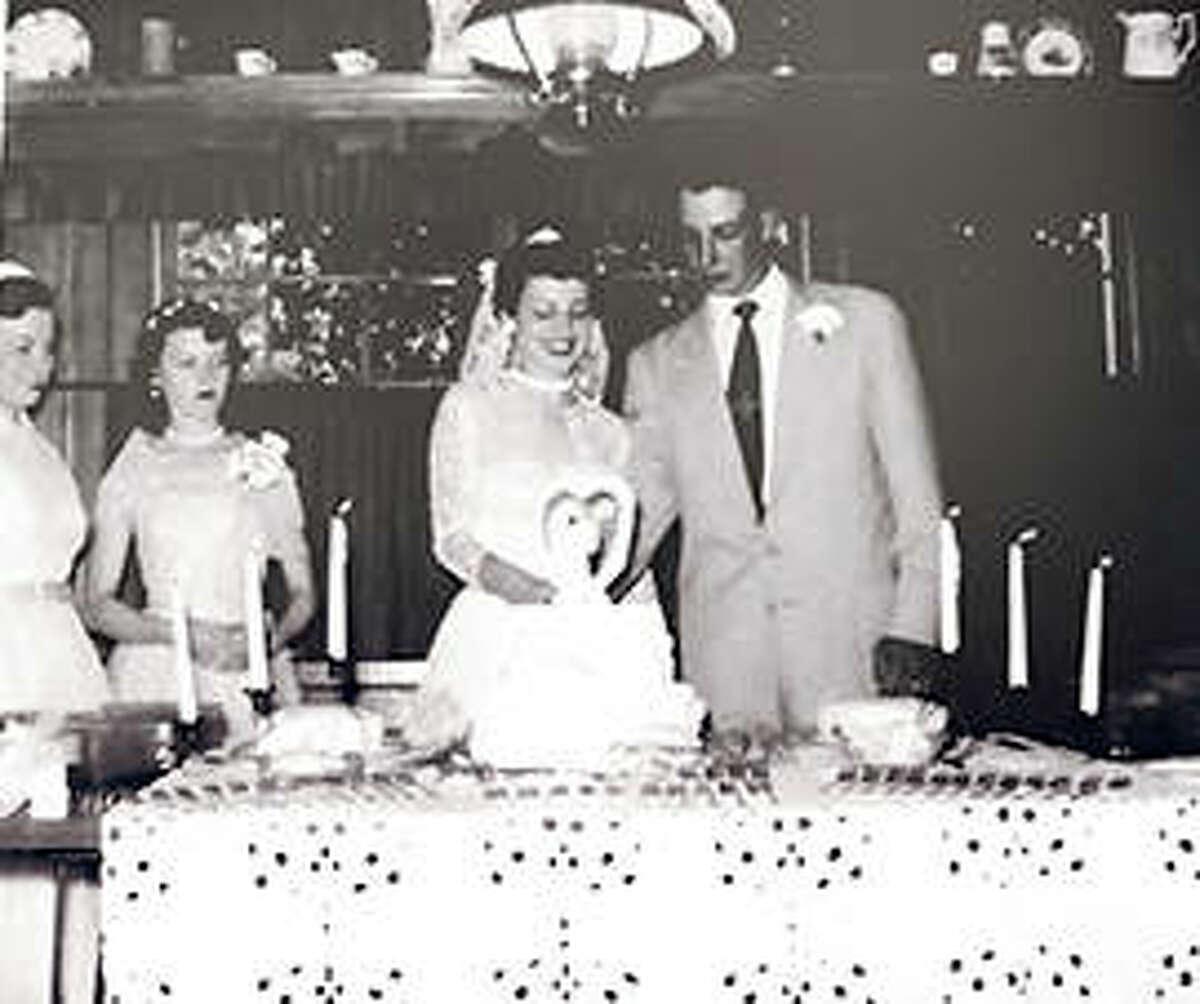 Gale and Bonnie Waltrip cut their wedding cake on July 4, 1954.