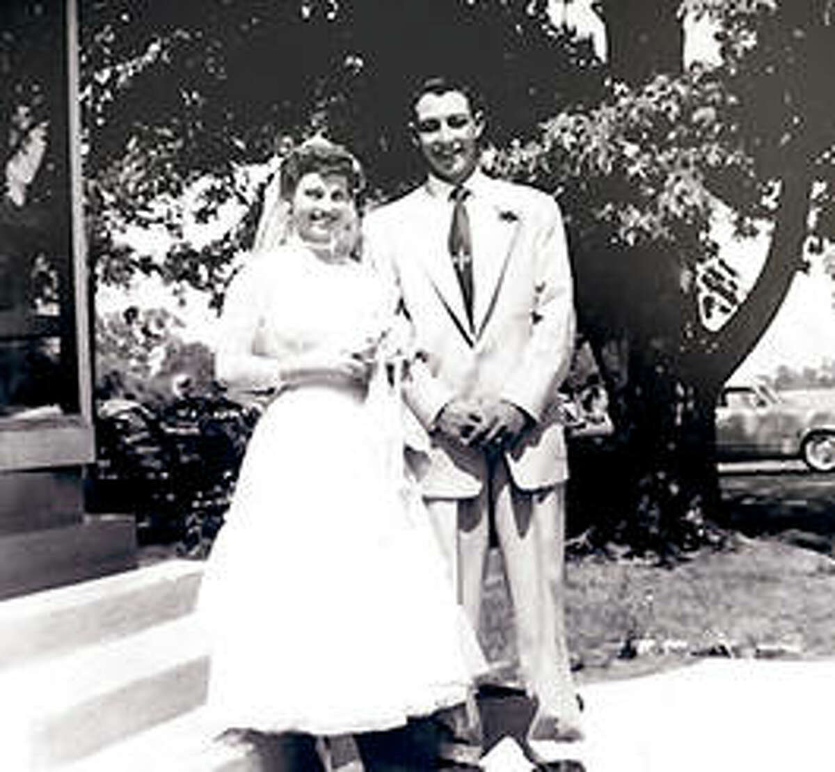 Gale and Bonnie Waltrip have wedding photos taken July 4, 1954.
