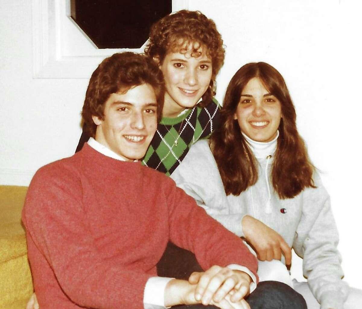 Stamford Advocate columnist Kevin McKeever, from left, Justine Metz andLesley Lane circa December 1985.