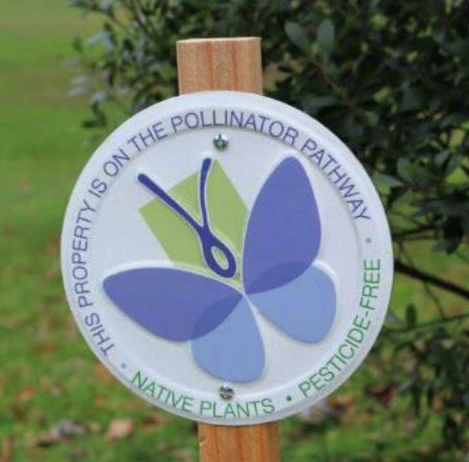 A plaque marks a spot along the Pollinator Pathway in Greenwich in this file photo. Photo: Contributed /
